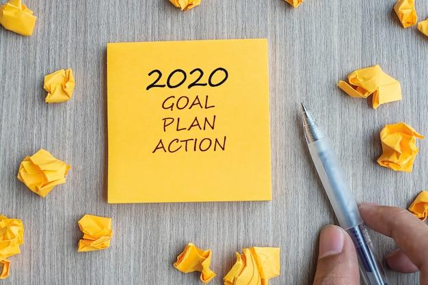2020 ziel, plan und aktion auf gelbe note