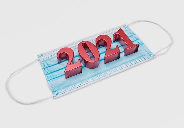 2021 neujahrszahlen liegen auf medizinischer maske