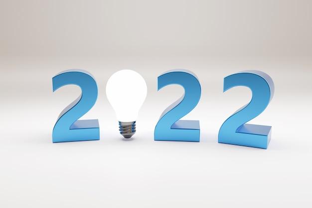 2022 text mit glühbirne in drei dimensionen. konzept für das neue jahr.