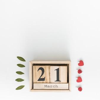 21. märz inschrift mit grünen blättern