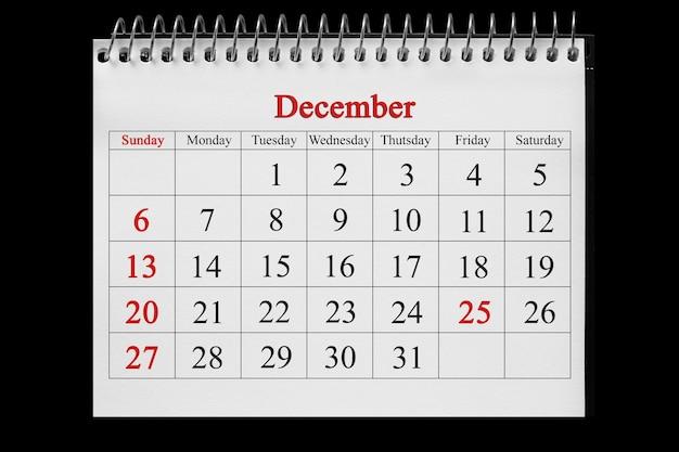 25. dezember im kalender auf dem holzhintergrund