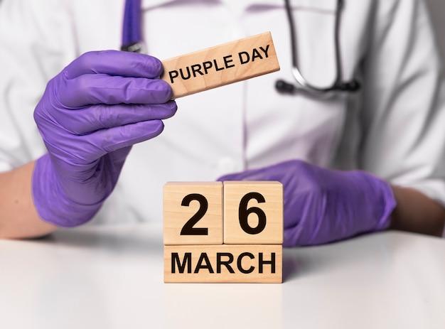 26. märz, datum auf holzkalender. lila tag der epilepsie der welt.