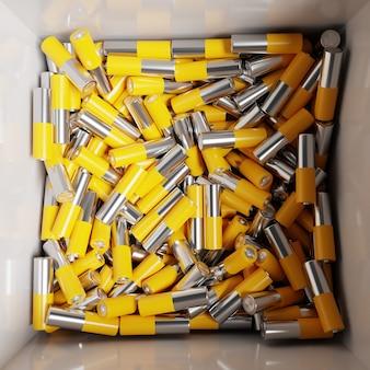 3d-darstellung aa-größe alkaline-batterie in einer box. eine nahaufnahme der gleichen gelben batterien, die in ordentlichen reihen positiver ladungen aufgereiht sind. eine unsichere art, energie zu nutzen.