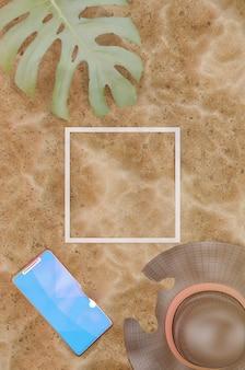 3d-darstellung. strand-sand-hintergrund. strohhut, tropisches blatt und handy auf sandigem hintergrund, draufsicht. weißes linienquadrat für logo und text