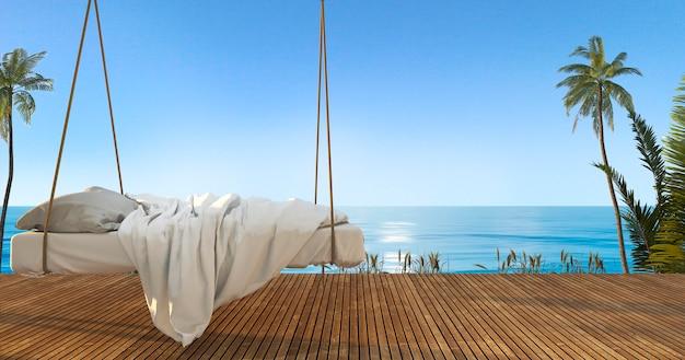 3d, das schönes hängendes bett auf terrasse nahe strand und meer überträgt Premium Fotos