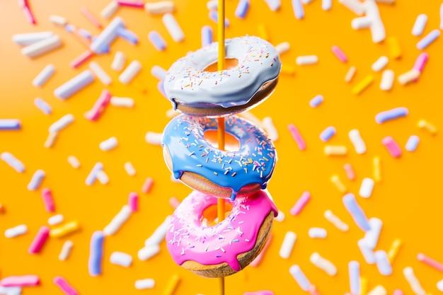 3d-illustration von drei mehrfarbigen köstlichen appetitlichen donuts schweben auf einem gelben geschmackvollen hintergrund