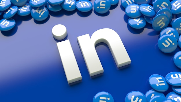 3d linkedin-logo über einem blauen hintergrund, umgeben von vielen glänzenden linkedin-pillen