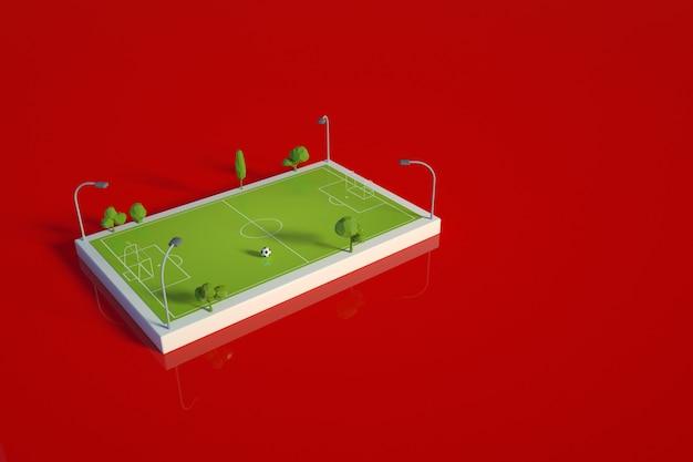 3d-modell eines sportfußballplatzes. fußballplatz, stadion, arena für wettbewerbe und training auf rotem, isoliertem hintergrund. vorlage, 3d-layout eines grünen fußballplatzes. draufsicht, seitenansicht