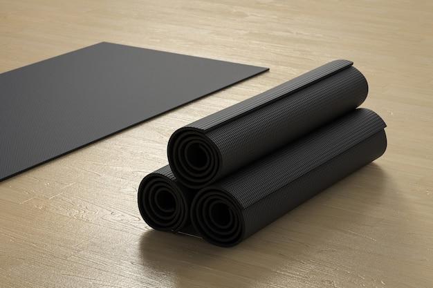 3d-rendering haufen schwarzer yogamatten auf dem boden