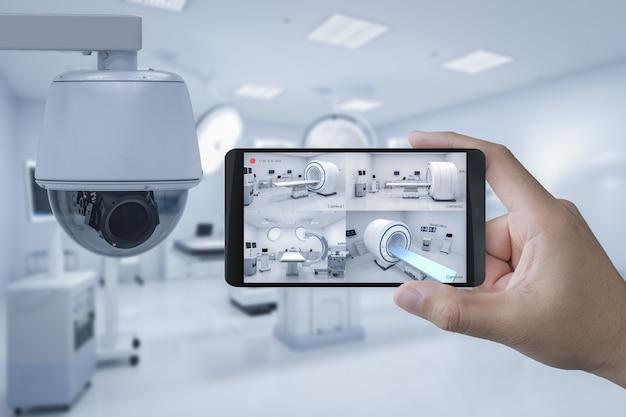 3d-rendering-mobile verbinden sich mit der überwachungskamera im krankenhaus