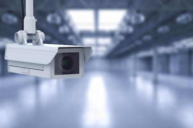 3d-rendering-überwachungskamera oder cctv-kamera in leerer fabrik