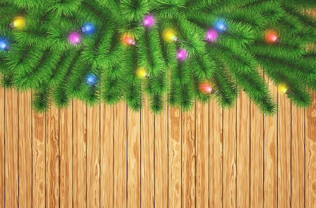 3d weihnachtsbaumaste mit lichtern auf einem hölzernen beschaffenheitshintergrund