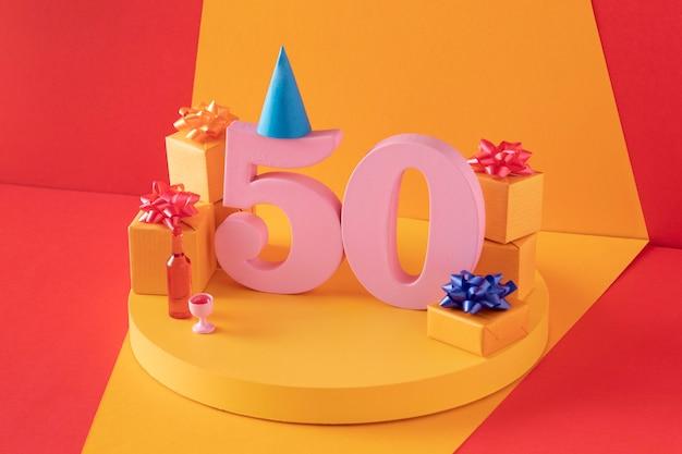 50. geburtstags-arrangement mit festlicher dekoration