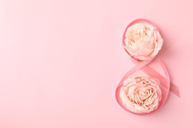 8 aus band und rosen auf rosa hintergrund
