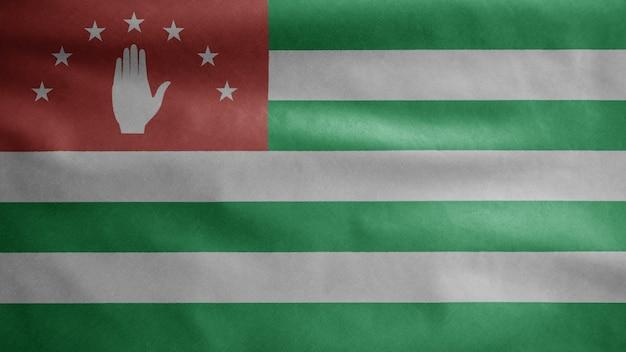 Abchasische flagge weht im wind. nahaufnahme von abchasien banner weht, weiche und glatte seide. stoff textur fähnrich hintergrund. verwenden sie es für das konzept für nationalfeiertage und länderanlässe.