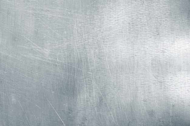 Abgenutzter stahlblechhintergrund, leichte metallbeschaffenheit mit kratzern und beulen