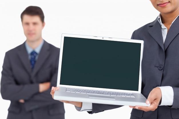 Abschluss oben des laptopbildschirmes, der durch salesteam dargestellt wird
