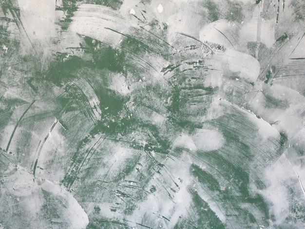 Abschlussarbeiten - grundierung der wand. reibende grüne wand am alten haus.