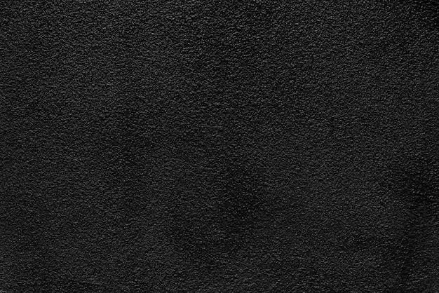 Abstact hintergrund von der schwarzen konkreten beschaffenheitswand. dunkler ton hintergrund.