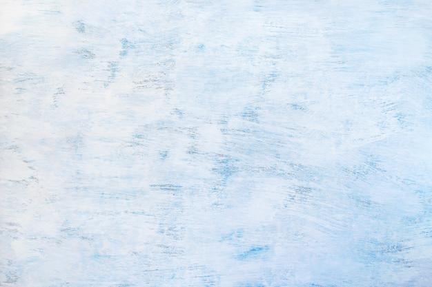 Abstrakt gemalter hellblauer hintergrund. blaue hölzerne beschaffenheit