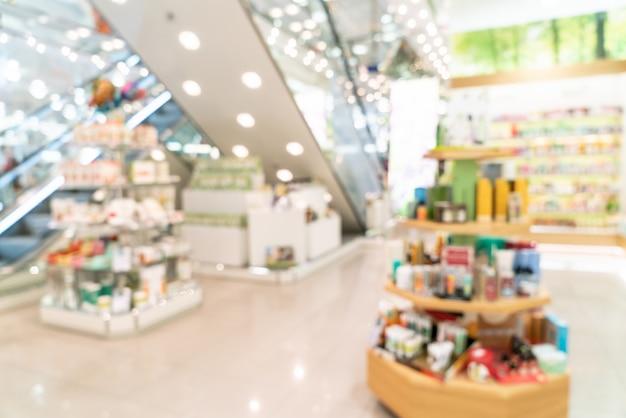 Abstrakt verschwommenes supermarktinterieur