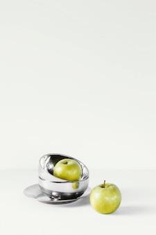 Abstrakte äpfel und schalen mit minimalem konzept