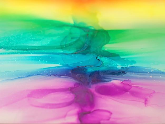 Abstrakte alkoholtinte regenbogen bunte hintergrundtapete mischen von acrylfarben moderne kunst