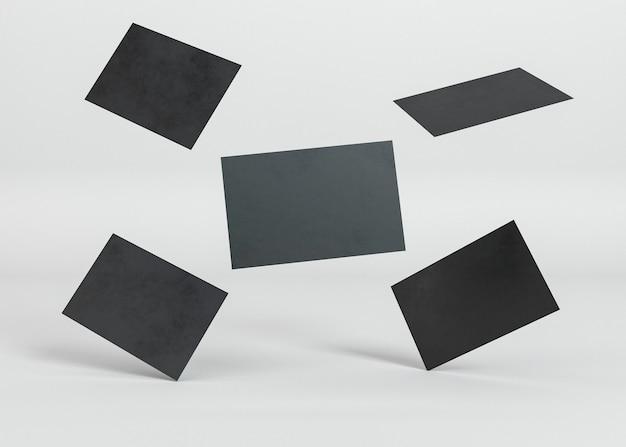 Abstrakte anordnung von visitenkarten des schwarzen kopienraums