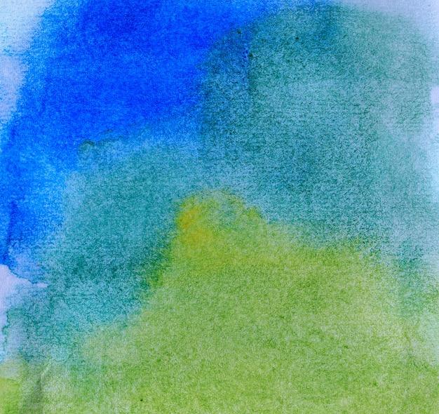 Abstrakte aquarellhand gezeichnet für schöne pastellgrün- und gelbtöne des hintergrundes