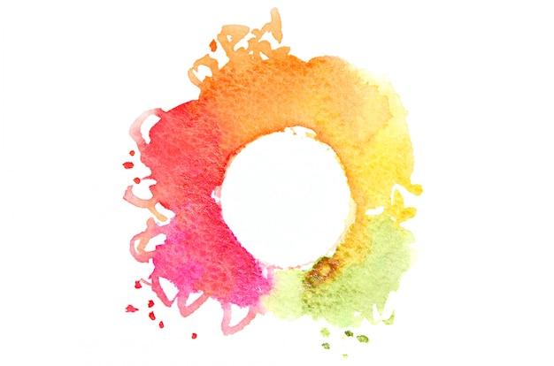 Abstrakte aquarellpunkte, die eine gelegentliche form der verschiedenen farben mit einem runden platz für text bilden
