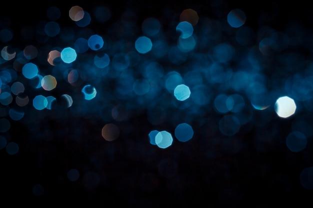 Abstrakte blaue bokeh beschaffenheit auf schwarzem hintergrund