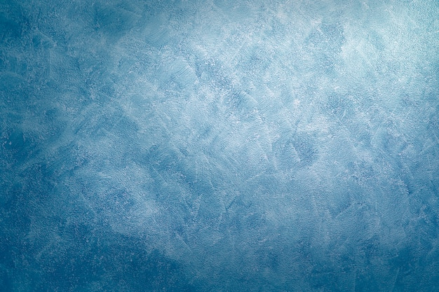Abstrakte blaue farbe malen. entworfener schmutz auf wandbeschaffenheit