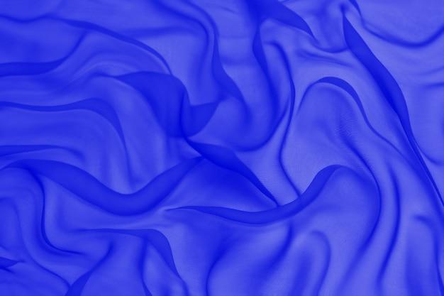 Abstrakte blaue farbe seide chiffon stoff textur hintergrund.