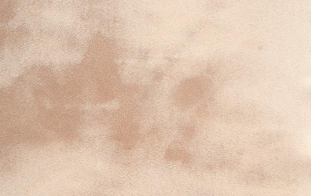Abstrakte braune wand mit fleckbeschaffenheitshintergrund