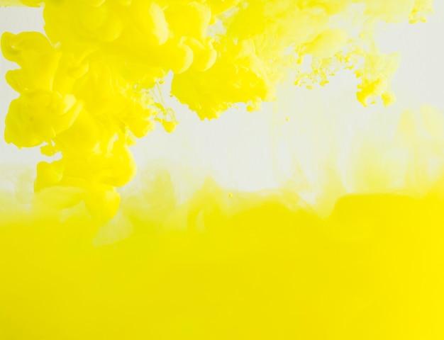 Abstrakte dichte gelbe wolke des dunstes