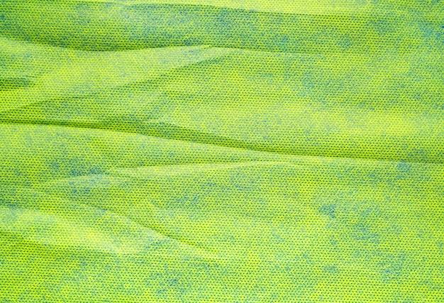 Abstrakte falten grün blau papier textur hintergrund