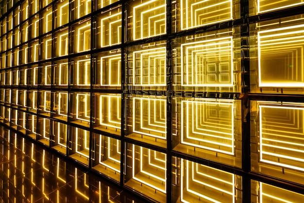 Abstrakte gelbe fluoreszierende hintergrundwand
