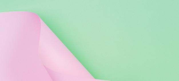 Abstrakte geometrische form pastellrosa und grüne farbe papierwand