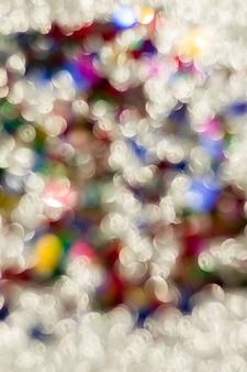 Abstrakte glitzerfarbe beleuchtet chrismas hintergrund. de-fokussiert