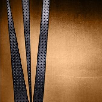 Abstrakte gold metall textur auf einem perforierten metallischen hintergrund