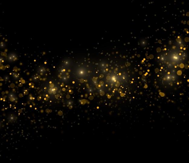Abstrakte goldene funken auf schwarzem hintergrund