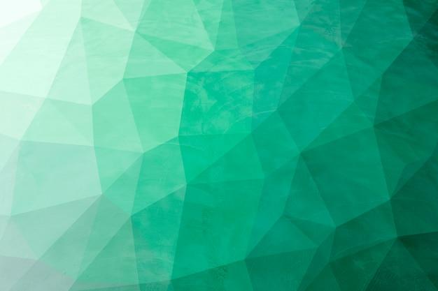 Abstrakte grüne niedrige polyhintergrundbeschaffenheit. kreative polygonale hintergrundillustration