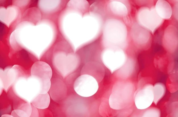 Abstrakte herzen und roter bokeh lichthintergrund für valentinsgrußtag