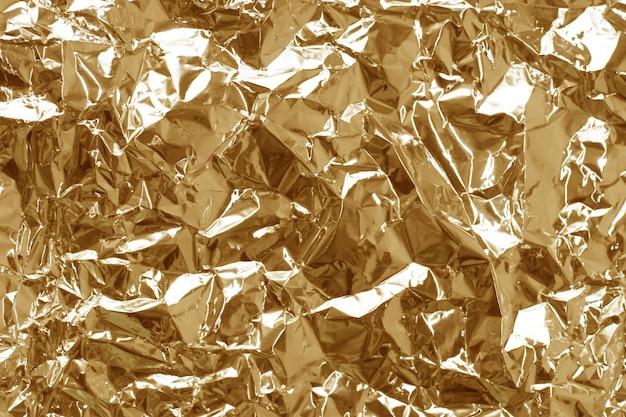 Abstrakte hintergrundtextur aus metallischer goldfolie
