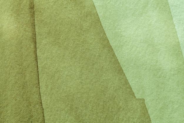 Abstrakte kunst hintergrundlicht oliv und grüne farben. aquarellmalerei auf leinwand mit weichem khaki-farbverlauf.