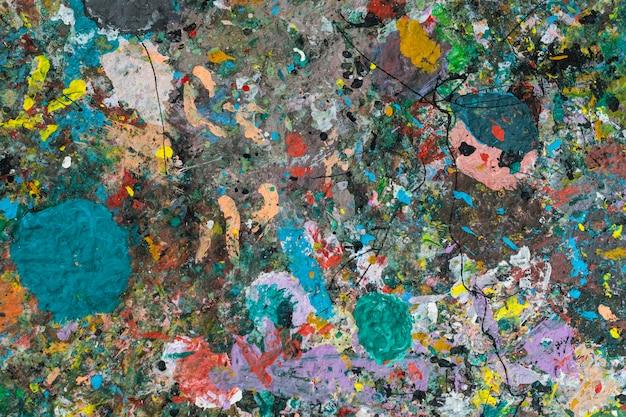 Abstrakte kunst textur mit gemischten farben acrylfarbe auf holzbrett