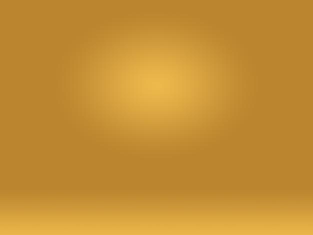 Abstrakte luxus-goldgelbe farbverlaufsstudiowand, gut als hintergrund, layout, banner und produktpräsentation verwenden. Kostenlose Fotos