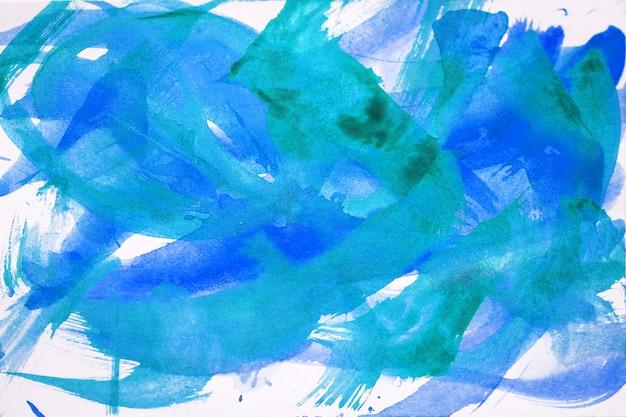 Abstrakte pinselstriche und farbspritzer auf papier. aquarellbeschaffenheit für kreativen hintergrund