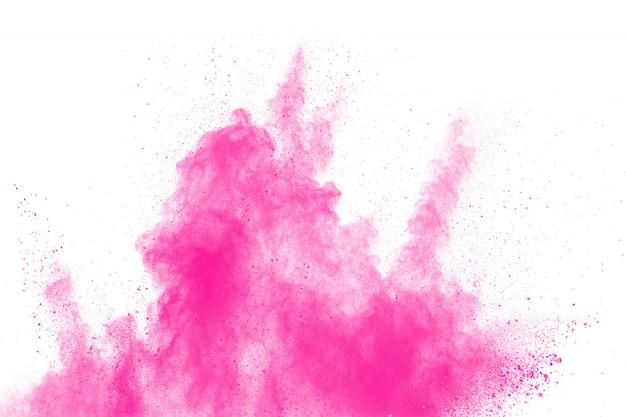 Abstrakte rosafarbene staubexplosion auf weißem hintergrund.