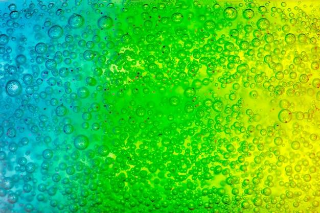 Abstrakte strukturierte oberfläche mit blauem und grünem gel